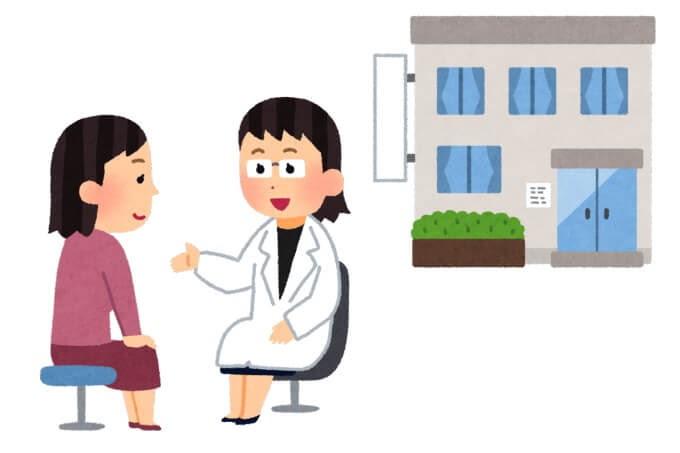 病院で医者と話しているイラスト