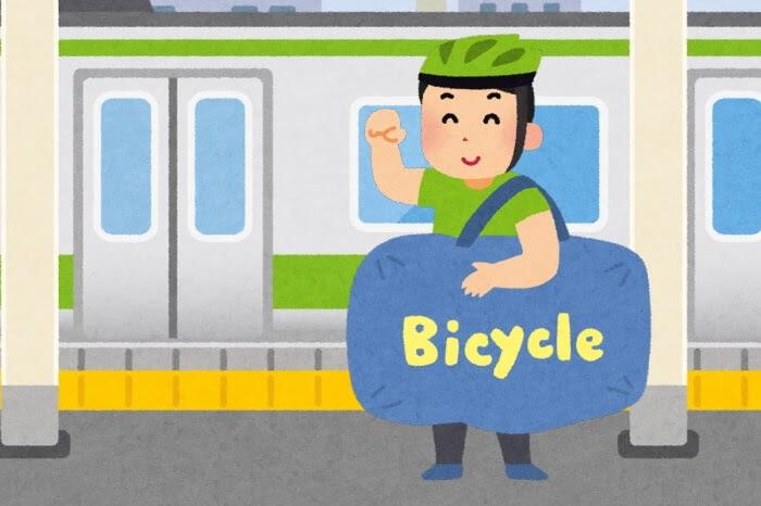 男性が駅で輪行しているイラスト